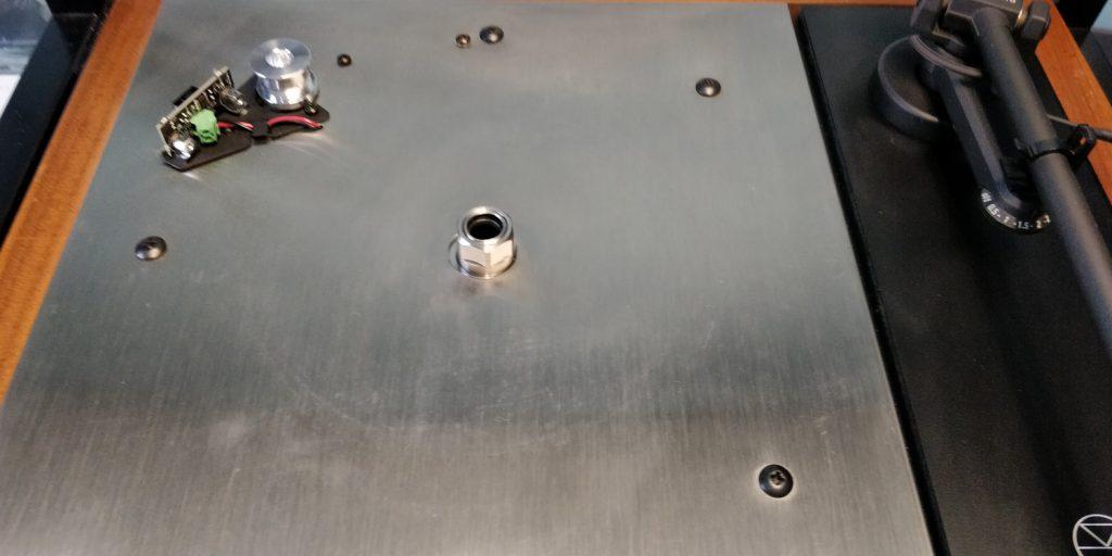 Karousel bearing poking through the top plate